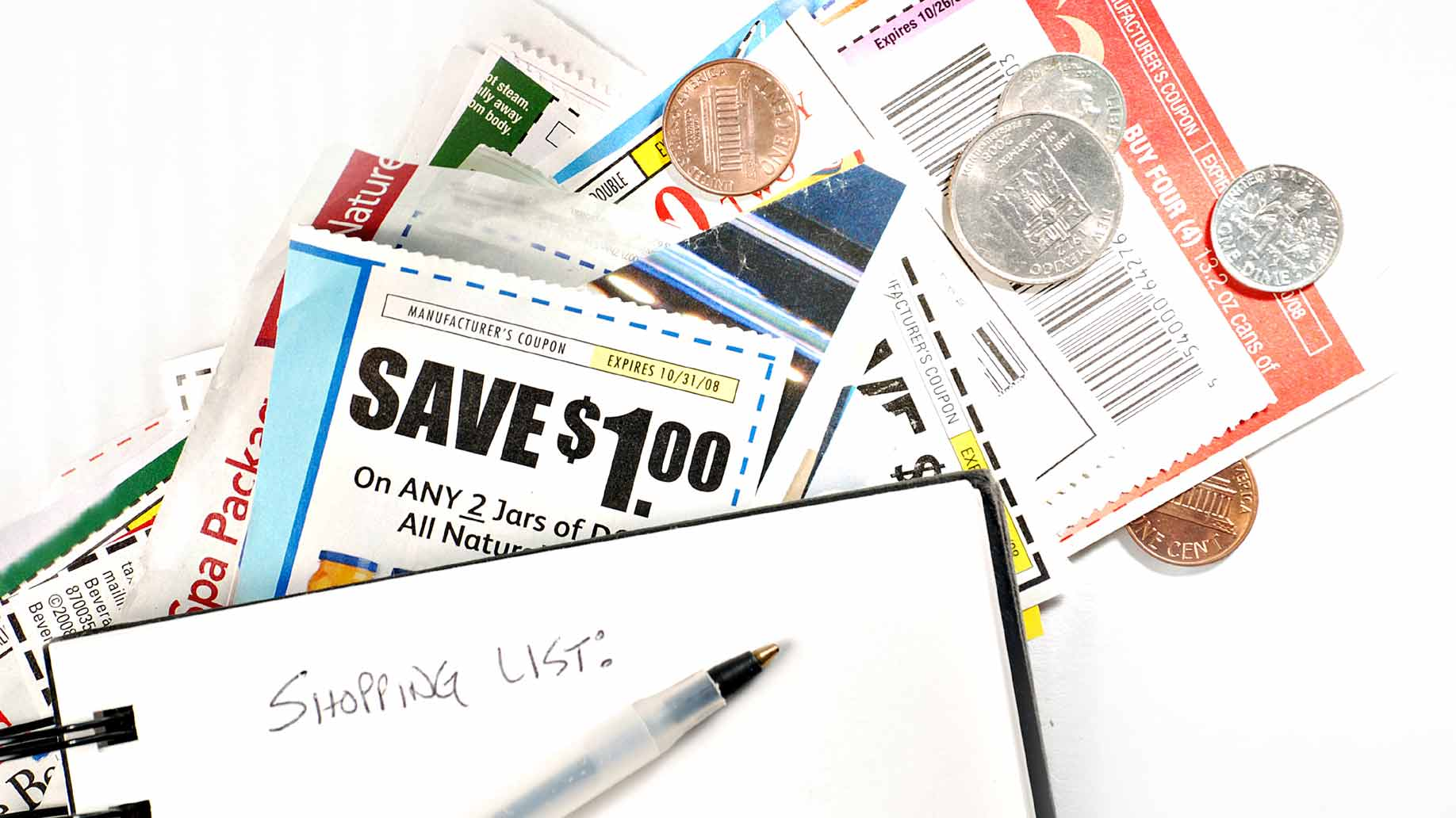 shopping list and paper coupons
