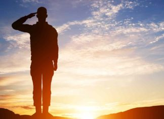 soldier salute silhouette on sunset sky?