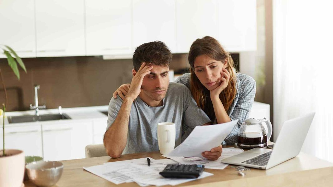 unhappy american couple managing home accounts?