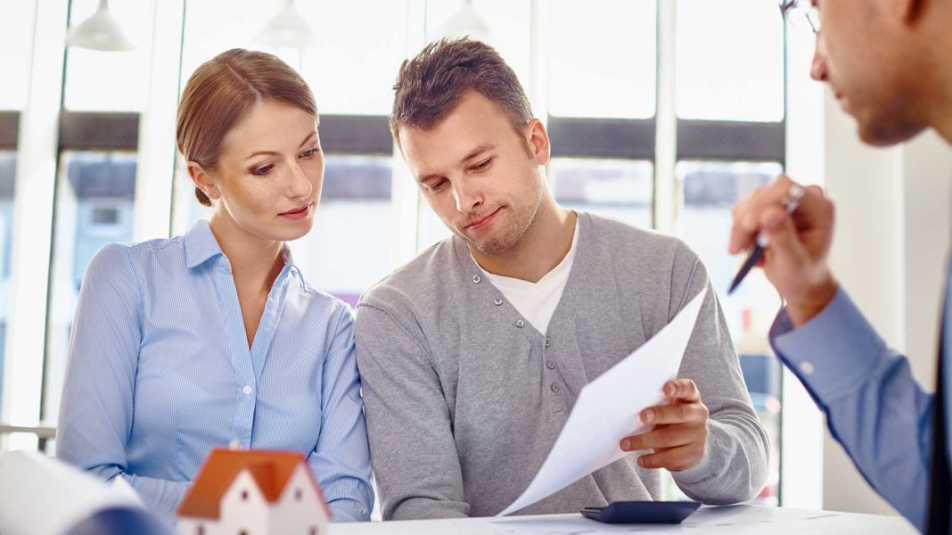 young couple reading loan contract new?
