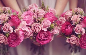bridesmaids with pink posies