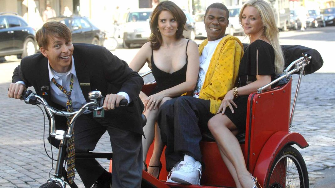 Jack McBrayer, Tina Fey, Tracy Morgan and Jane Krakowski promoting 30 Rock on a pedicab, photo courtesy Everett Collection