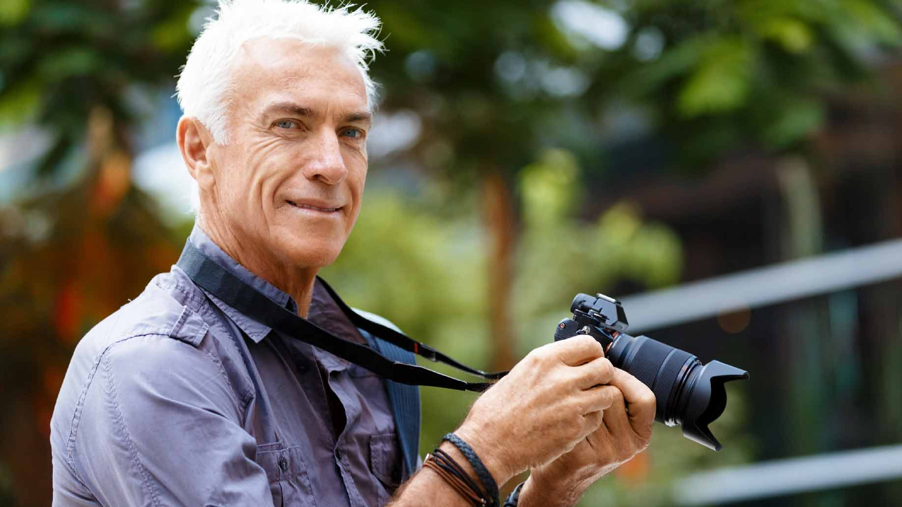 elderly man working as a freelance photographer