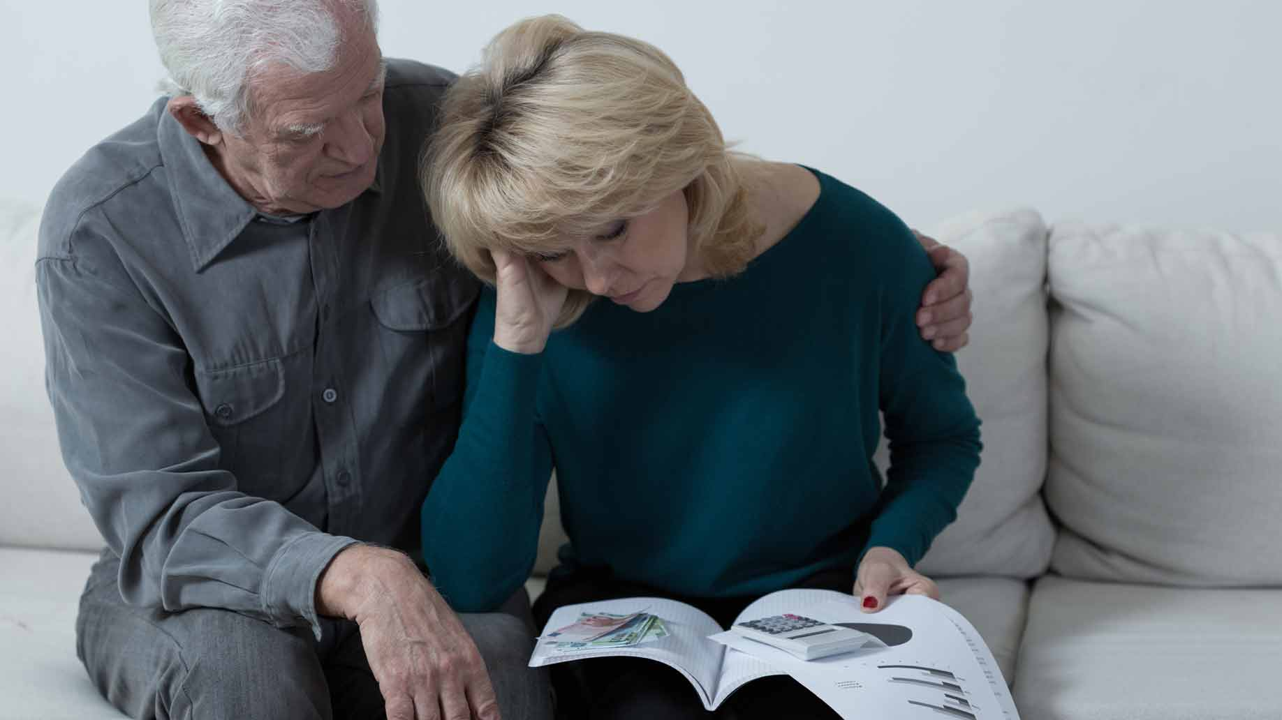 elderly couple with financial money problems
