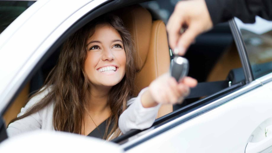 woman receives keys to her new car