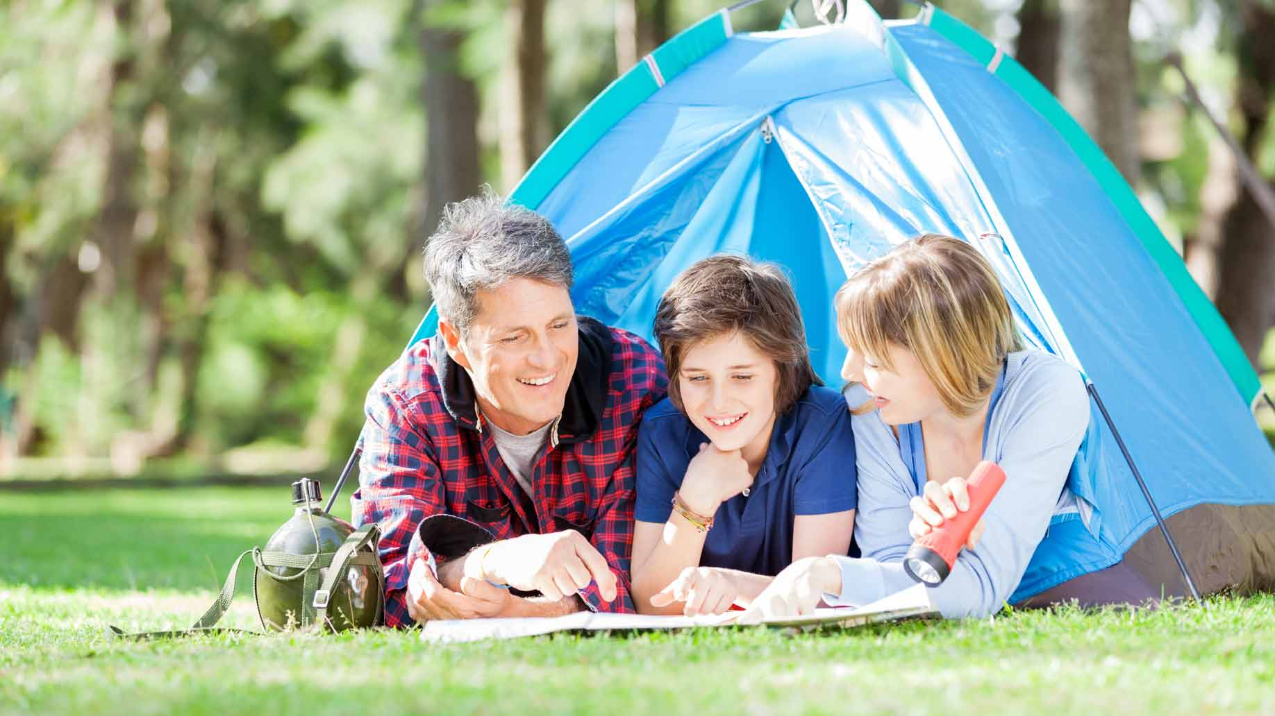 dad camping in the backyard with kids