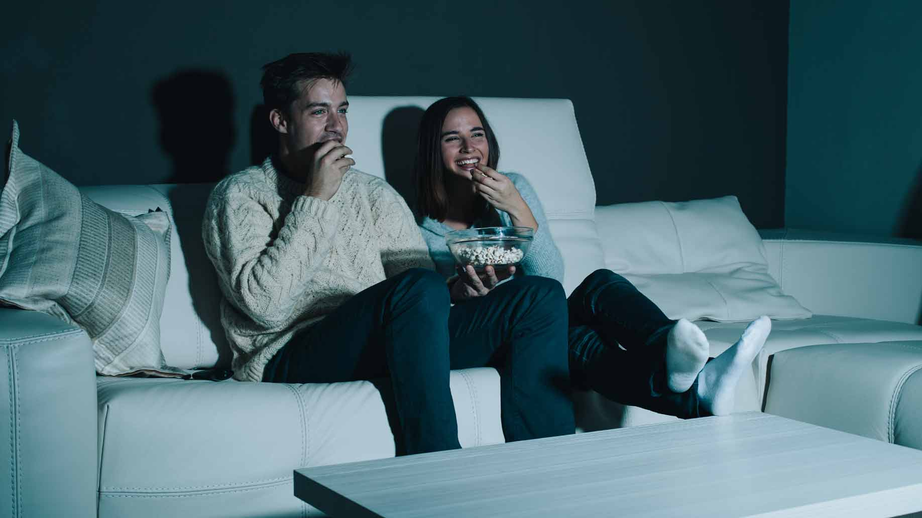 couple watching movie at home