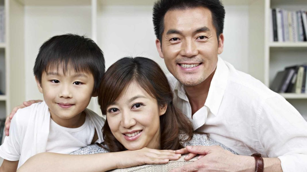 asian-american family with child