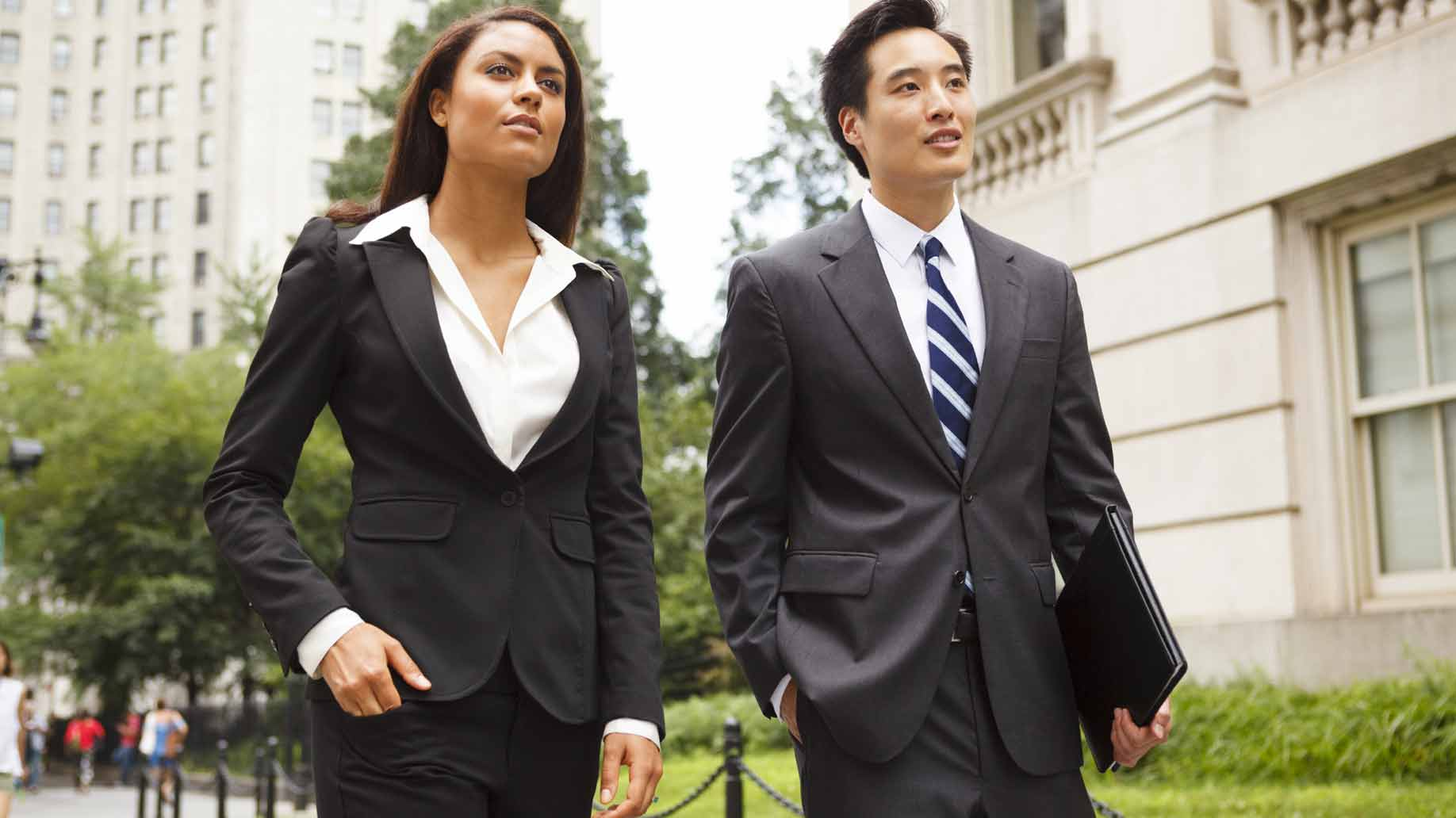 a man and a woman in professional business attire