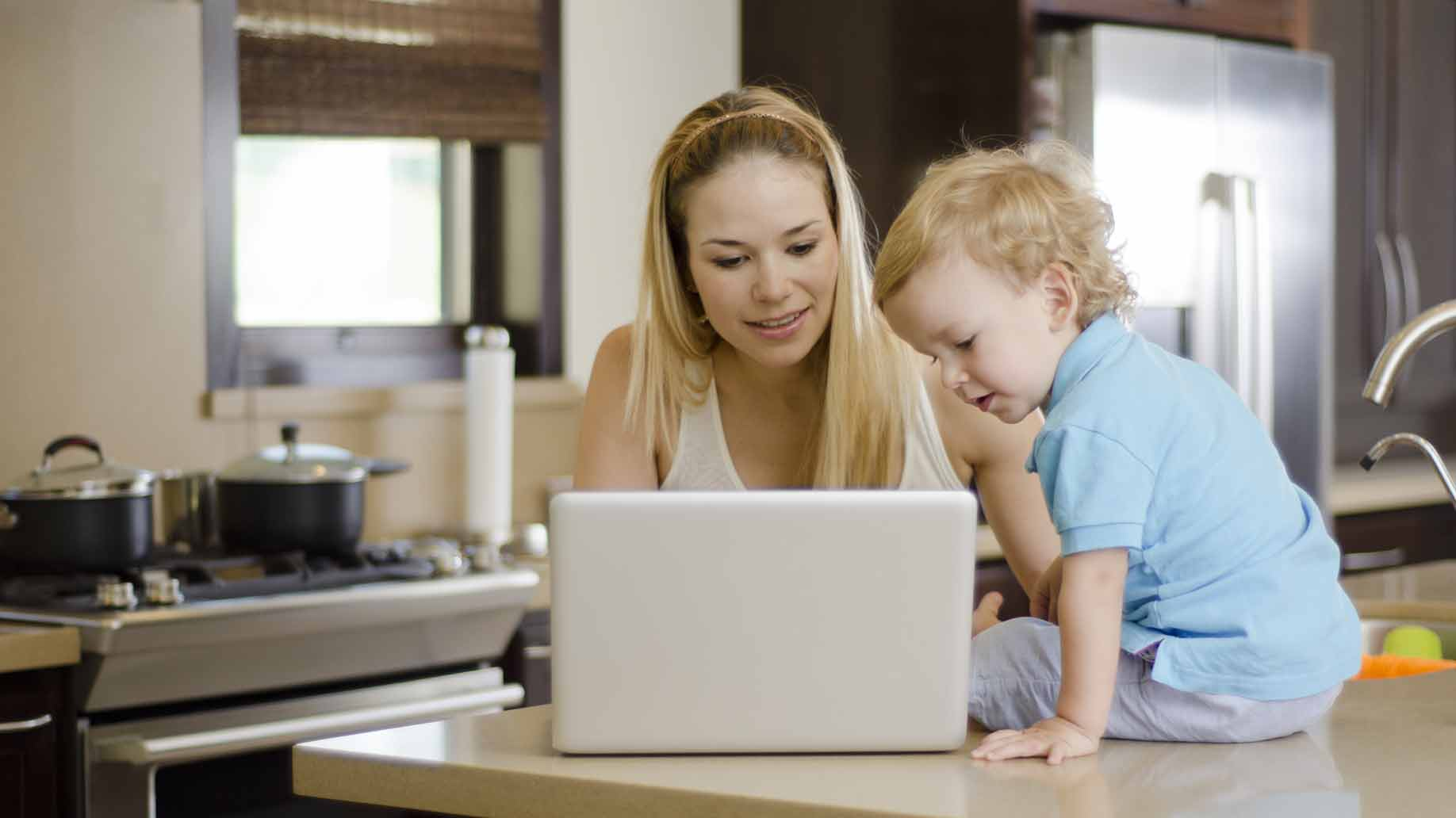 mom and toddler shopping for baby items online