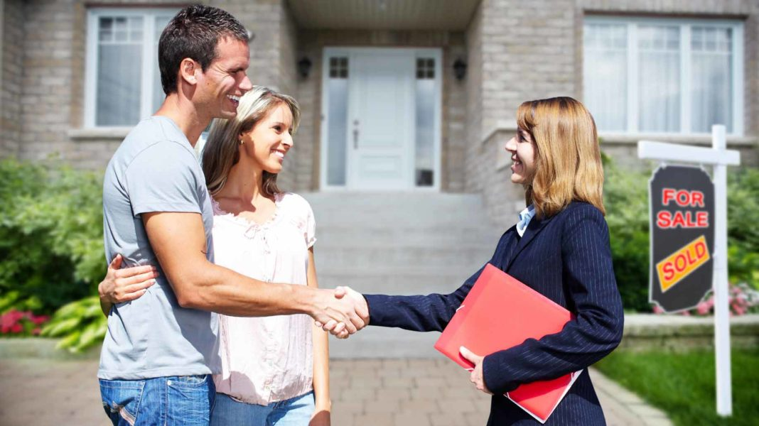 husband and wife closing on a new house purchase