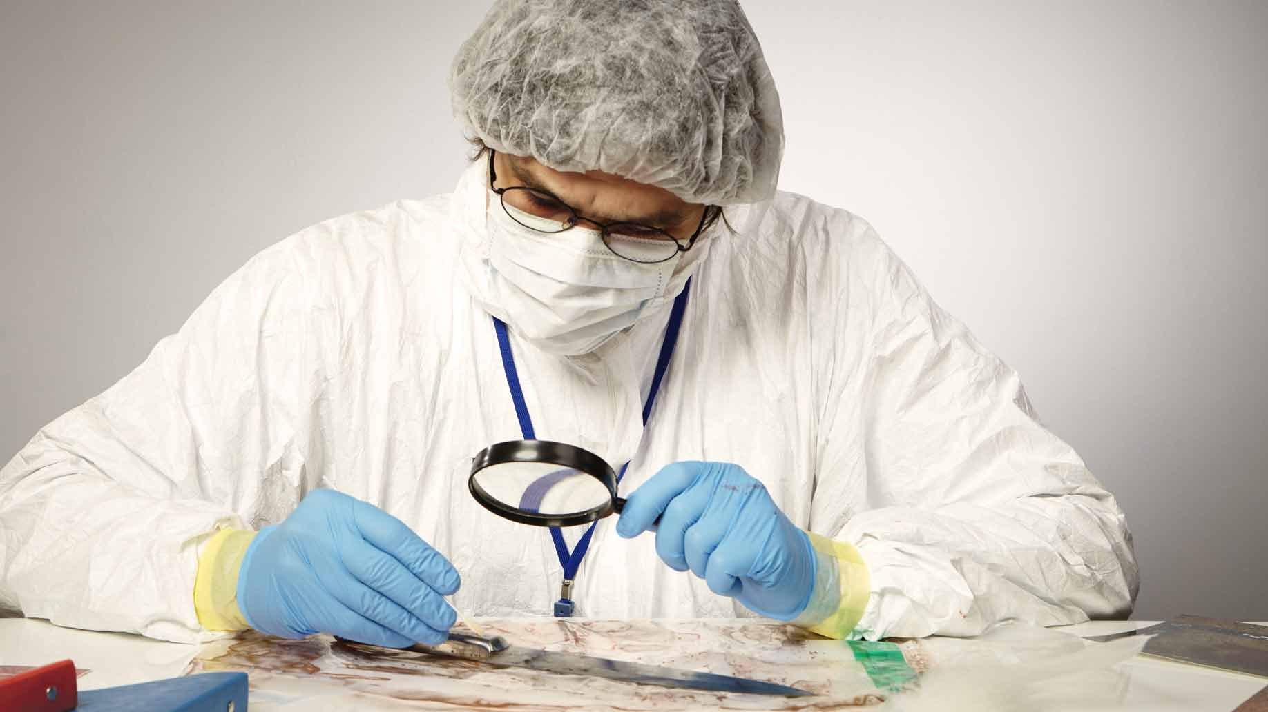 forensic scientist examines evidence