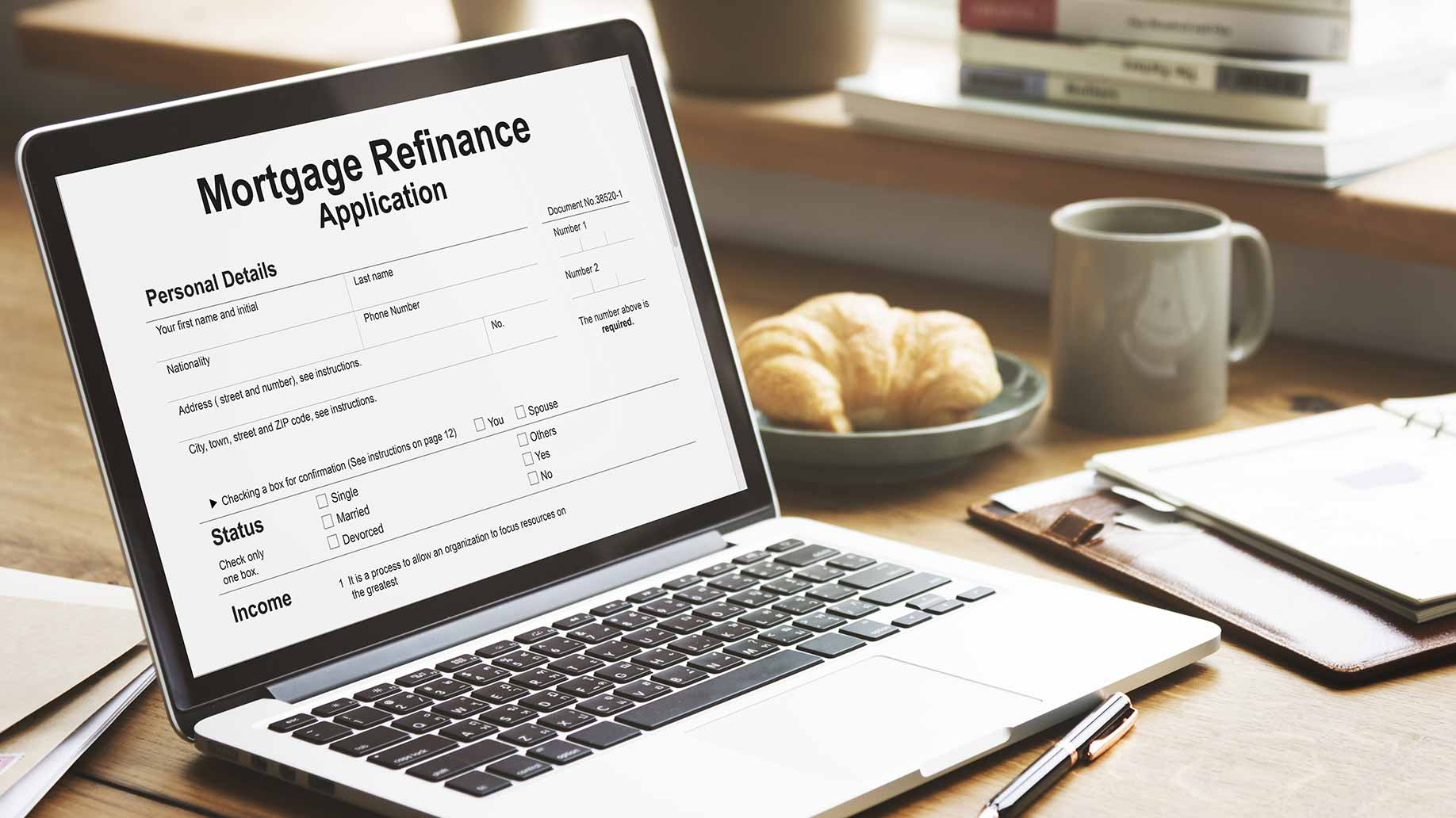 mortgage refinance application form open on laptop