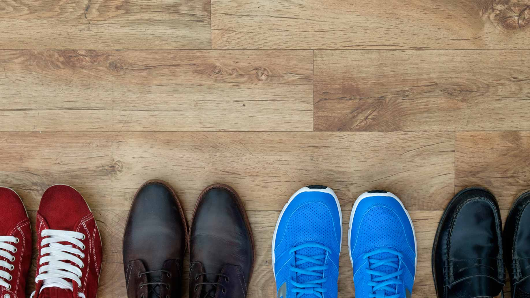 shoe collection lined up on wooden floor running shoes dress shoes