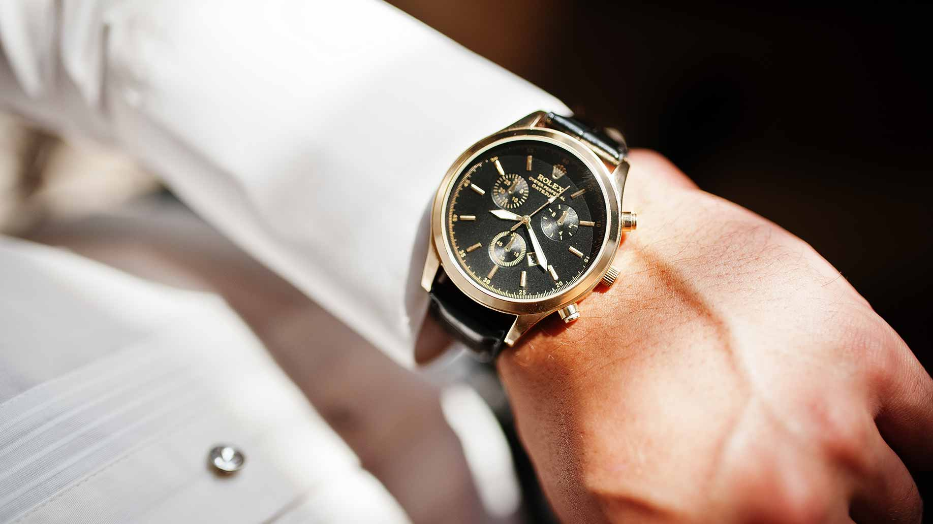 expensive rolex watch on hand