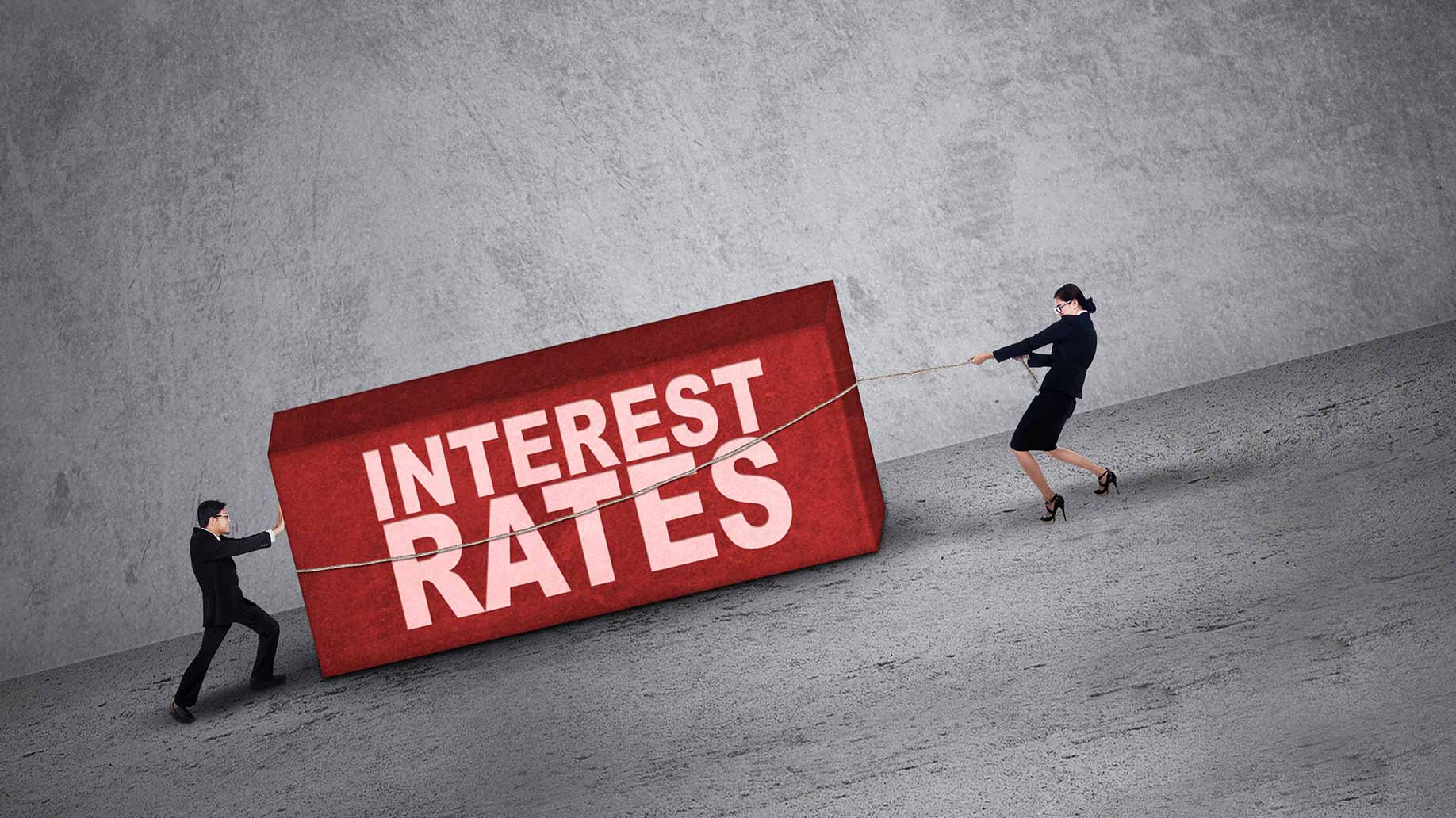 two people struggling with high interest rates