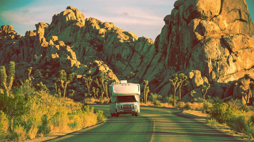 rv traveling along the highway in joshua tree, california
