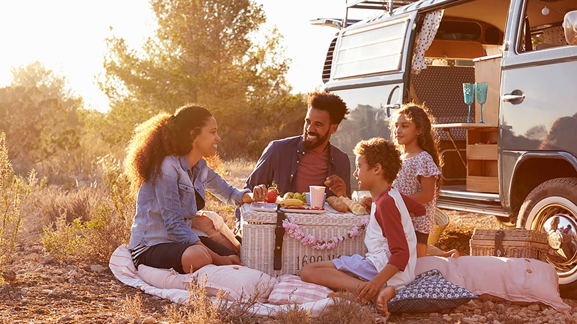 a family camping beside their parked rv