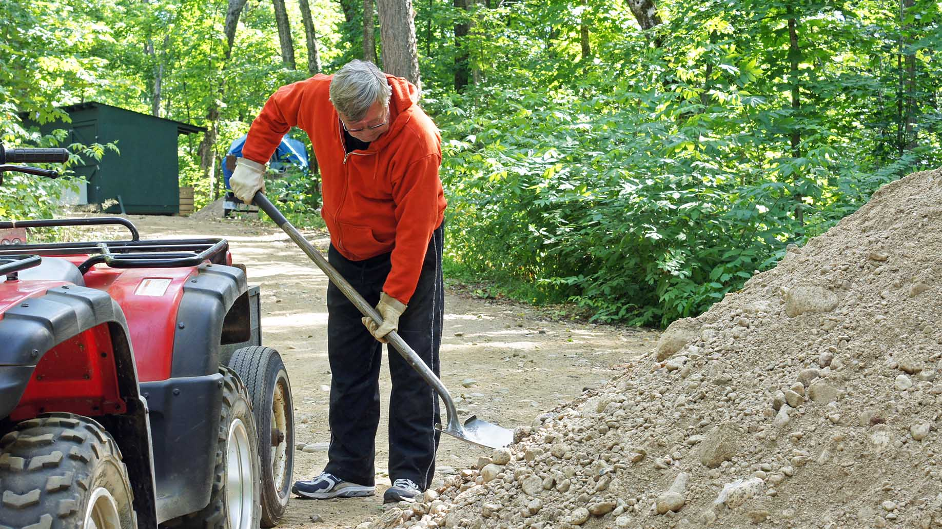 man works moving grave