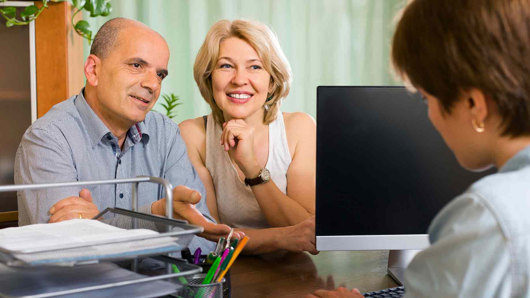 public notary helping happy aged couple