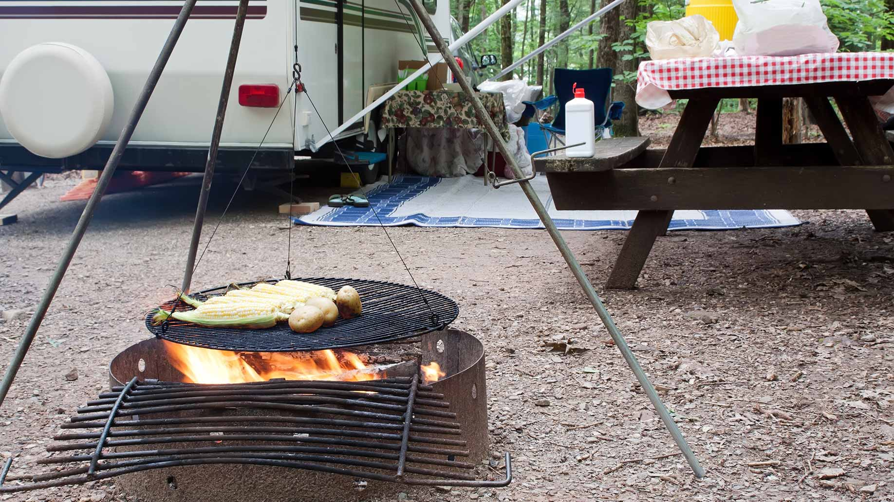 corn and potatoes cooking over a fire at an rv campground