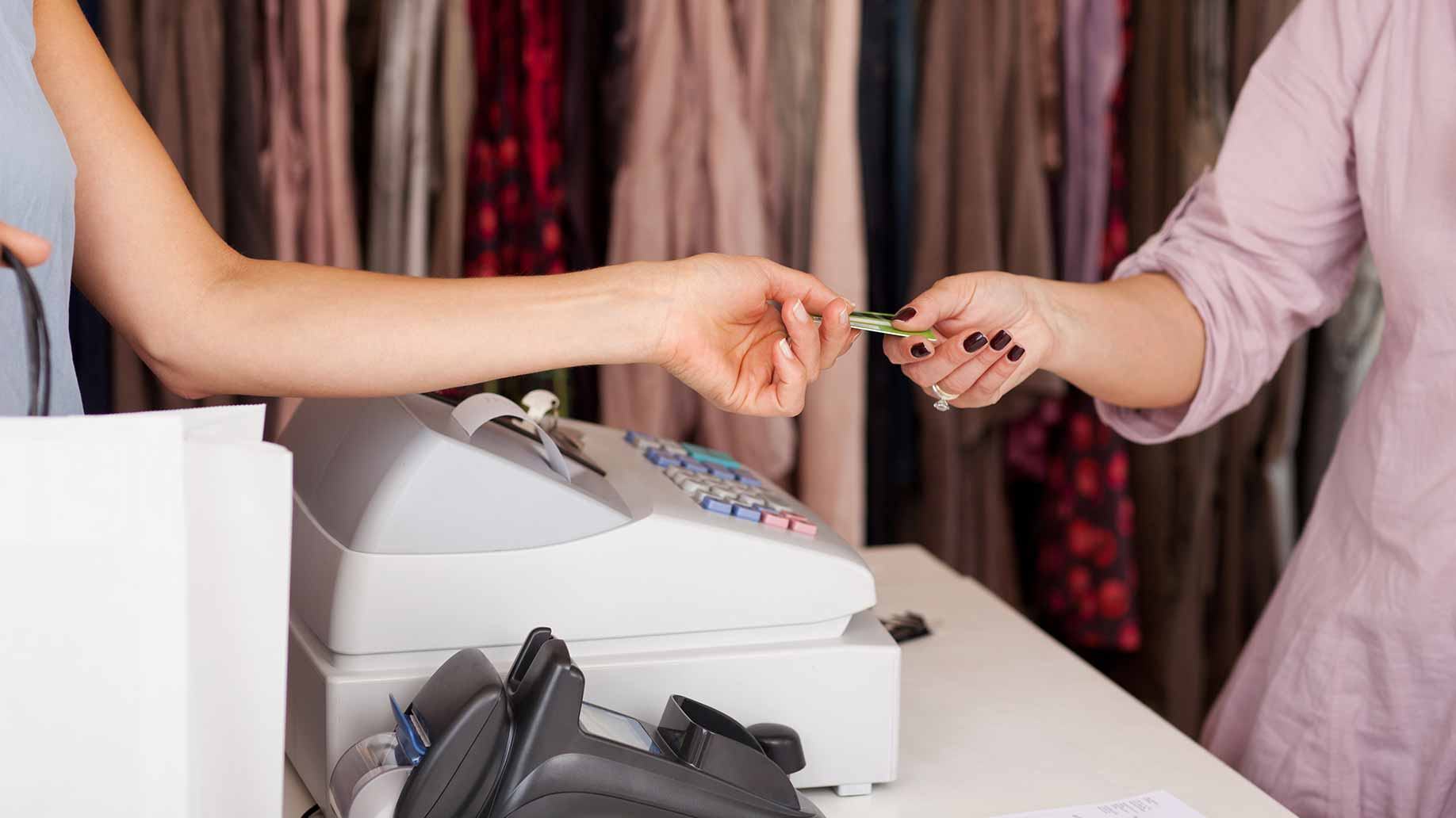 handing over credit card in a clothing boutique
