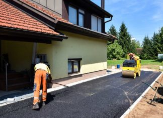 team workers constructing asphalt road