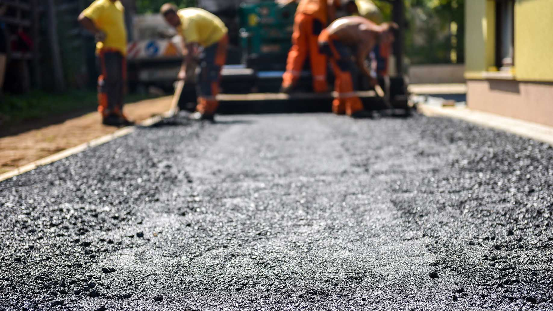 workers constructing asphalt road