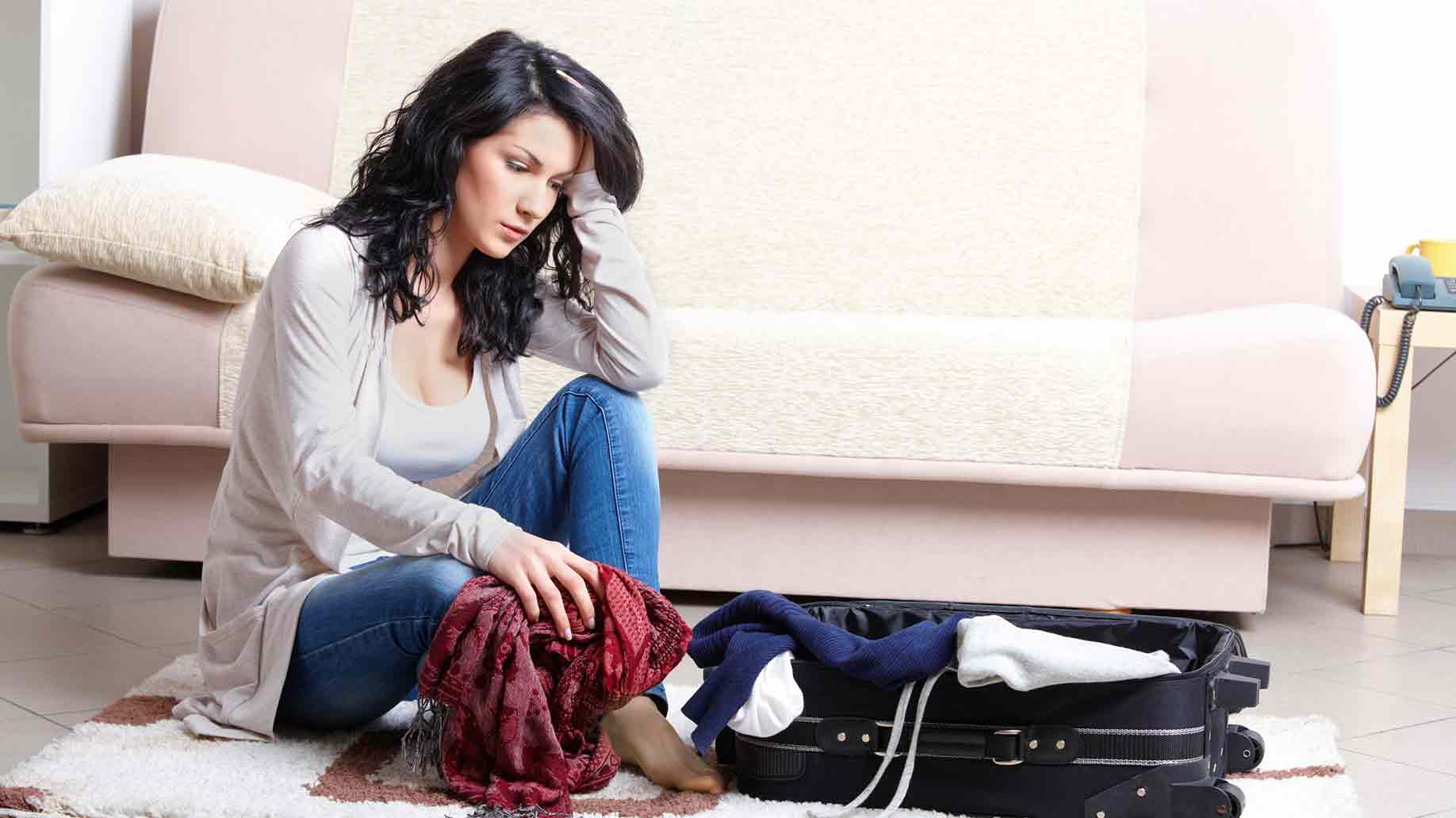 young girl preparing her luggage