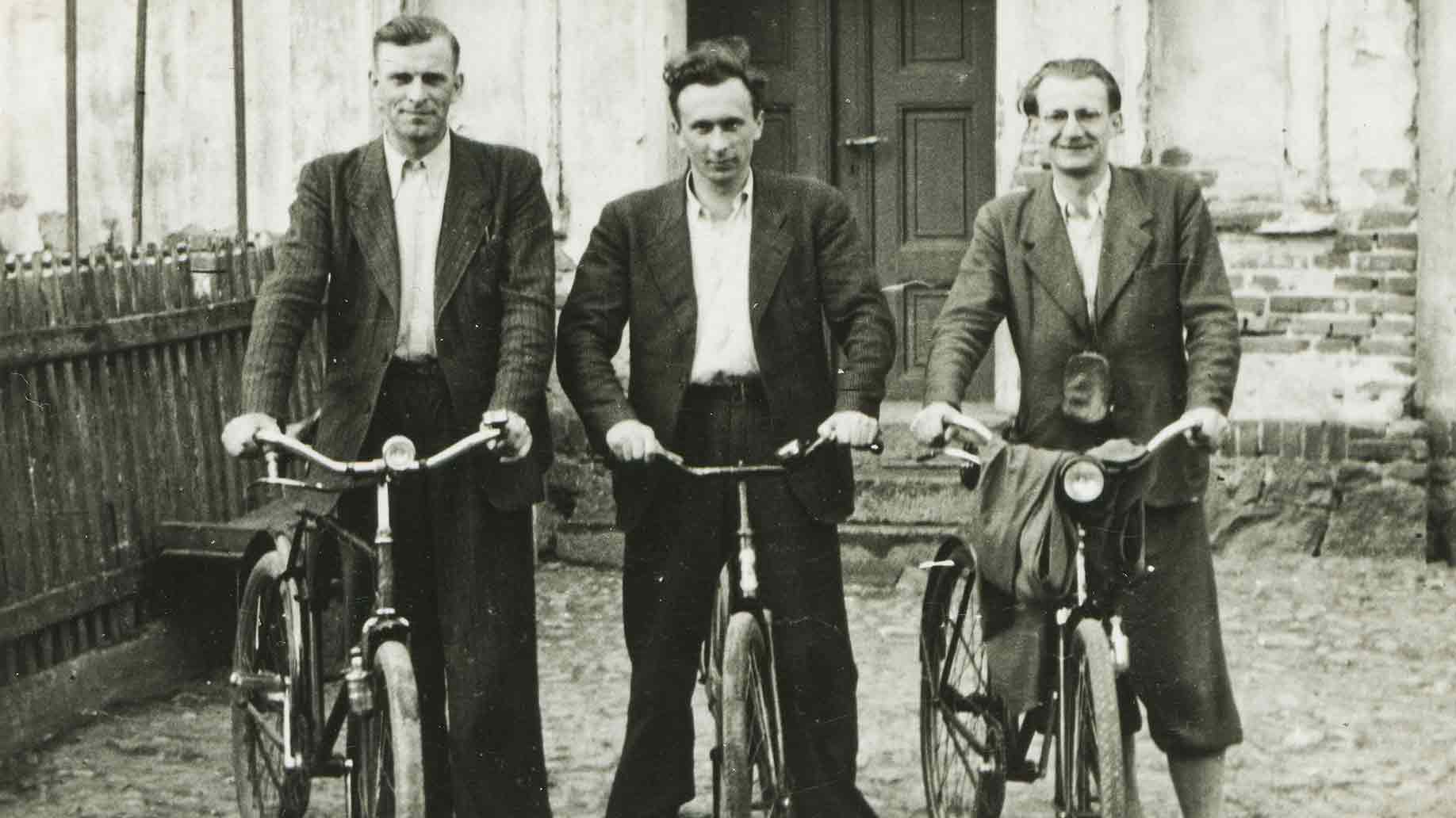 vintage photo of three men bicycles forties