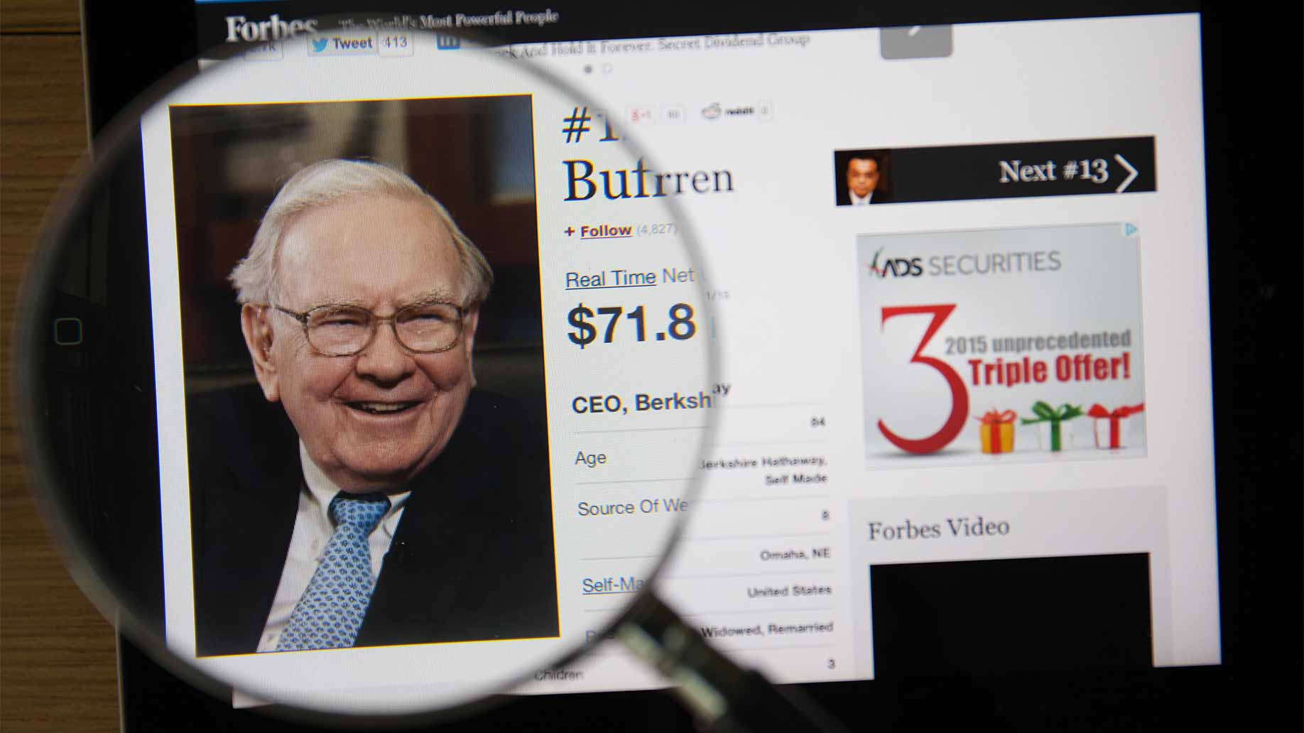 warren buffett webpage magnifying glass
