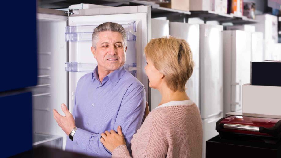 middleaged married couple shop appliances