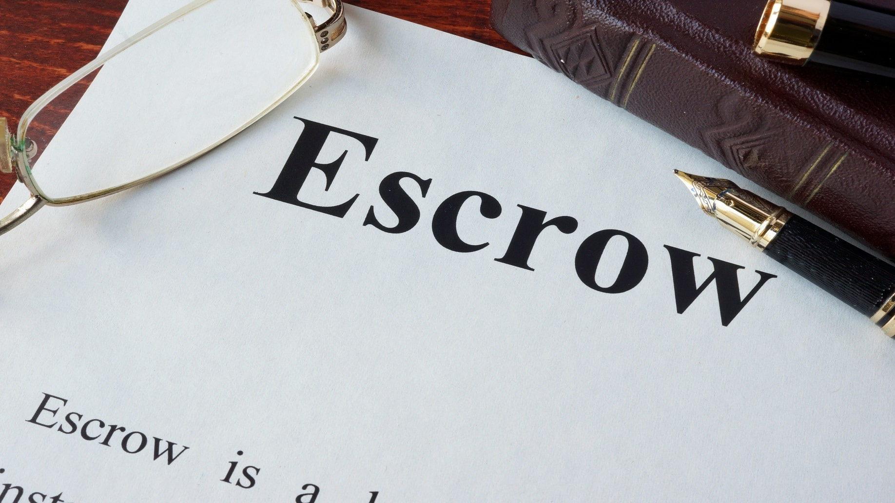 escrow on table