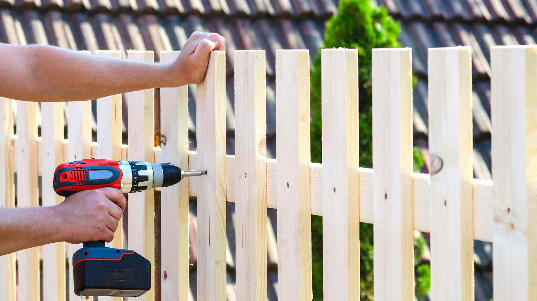 building wooden fence drill