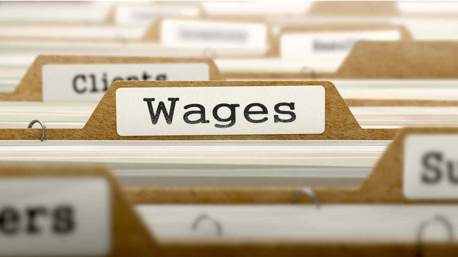wages concept word on folder