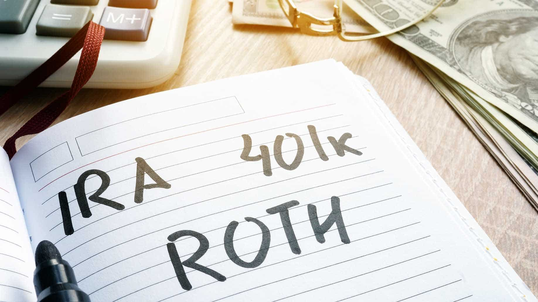 IRA 401k ROTH text written in a notebook