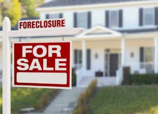 foreclosure fome signage for sale in front of house