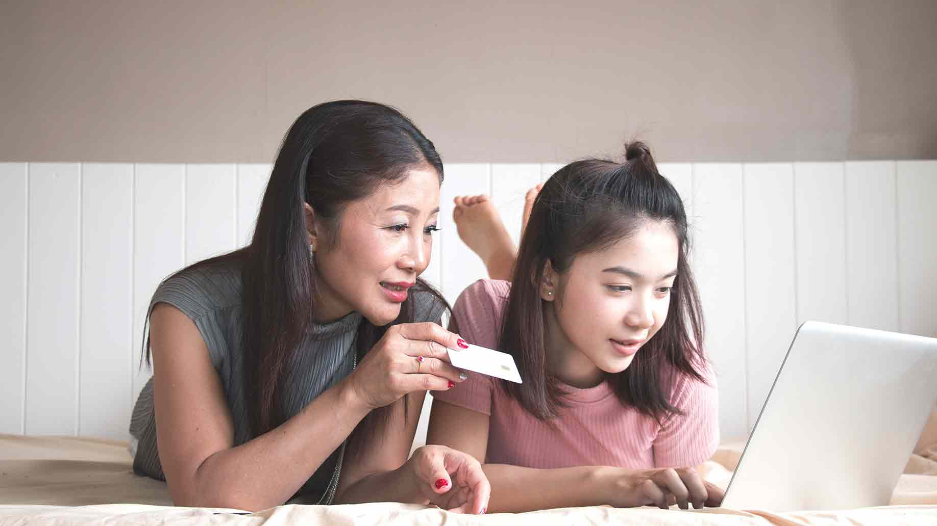 mother and daughter bonding buying online using computer