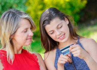 mother and daughter purchasing online with tablet