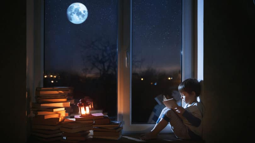 Toddler Boy Reading Pile Books Moonlight Window