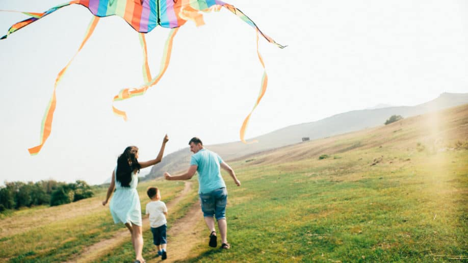 Family Flying Kite Outdoors