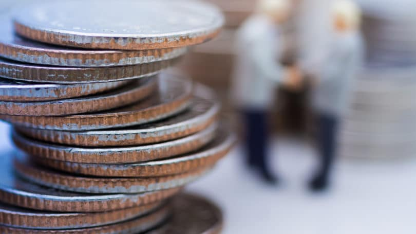 Coins Stacked Businessmen Shaking Hands