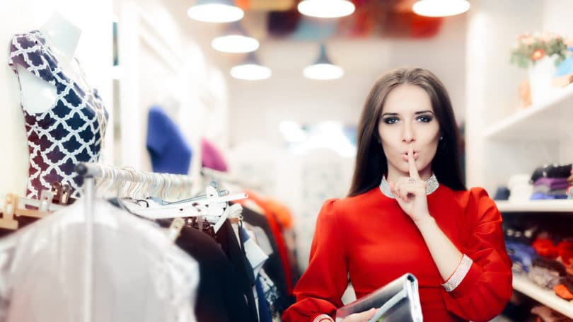 Mystery Shopper Store Woman Holding Finger To Lips