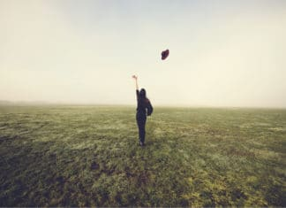 Letting Go Endowment Effect Woman Tossing Hat In Field