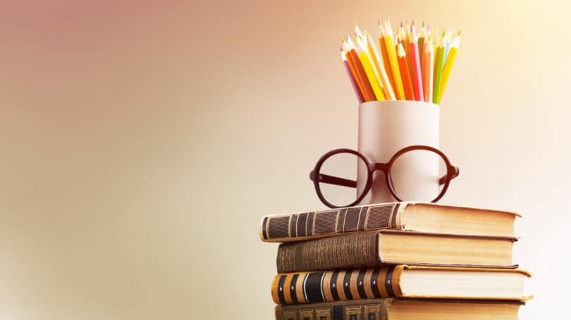 Teacher Glasses Classroom Pencils Colored Textbooks Stacked