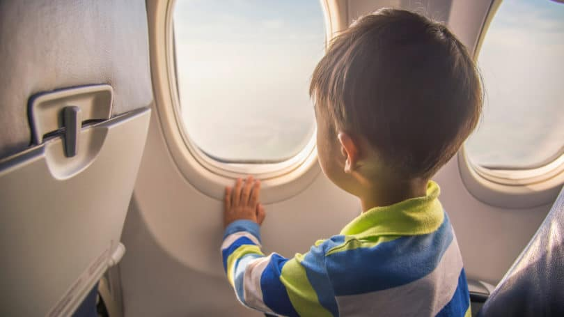 Boy On Plane Staring Out Window