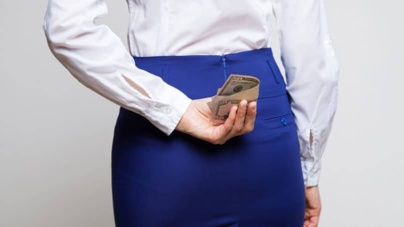 Woman Hiding Cash Behind Her Back Undeclared Income