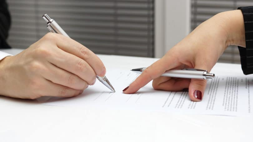 Pointing To Signature Contract Legal Documents Files Paperwork