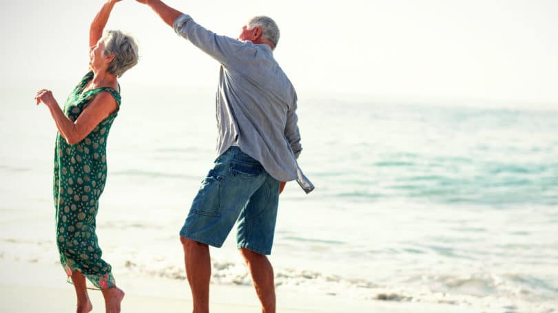 Retired Elderly Couple On The Beach Vacation