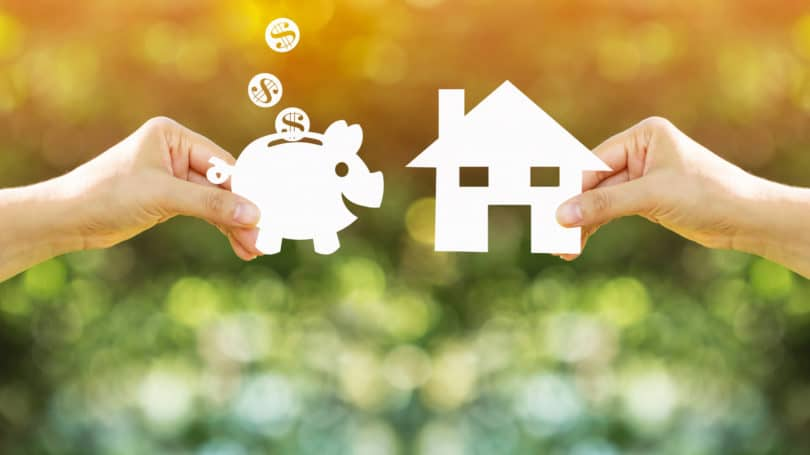 Saving Money In Piggy Bank For House Home
